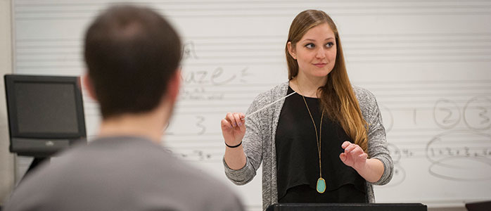 Jamie Wissett leads a conducting class in the music building.