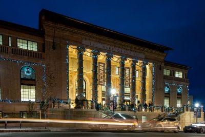 Hartford Times Building at UConn Hartford, lit up in blue lights during the holidays.